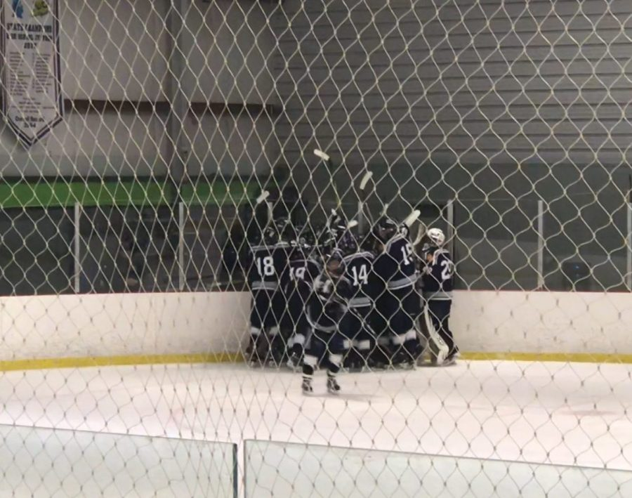 Huddling after an overtime winning goal by Brian Plohetski. Photo by Hunter Sutton