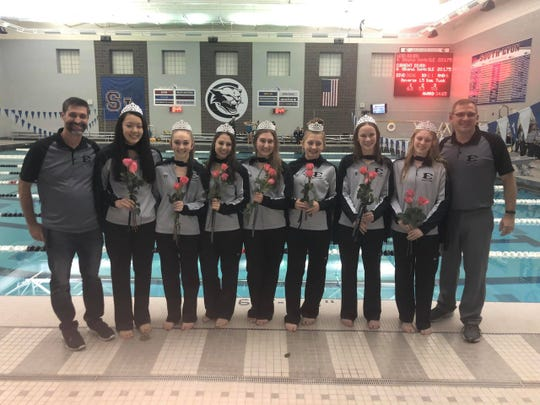 South Lyon East diving coach Kevin Ferguson, Hannah Sun, Alyssa Mayer, Melanie Cosens, Lindsay Boals, Sophia Ohland, Lindsey Filhart, Allison Engberg and swim coach John Burch celebrate senior night. Photo by Jill Ohland.